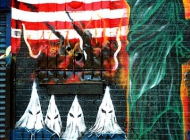 The skeleton of the Statue of Liberty, KKK and flames on the US flag (Bronx) New York Murales