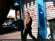 Man walking with his iguana on the shoulder | Man walking | New York Murales