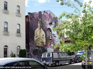 An house painted with a man and surrealistic background (Brooklyn) New York Murales