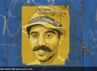 A face of a man on a yellow poster (Brooklyn) New York Murales