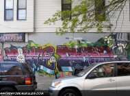 Matrioskas on a written and a man with a gun on the opposite side (Brooklyn) New York Murales