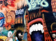 Two people entering into a mouth maybe to see a show | Another part of the cartoon style murales | New York Murales