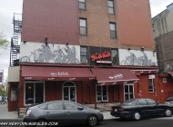 Motoebikes over a bar and restaurant in Lower East Side | Motorbikes | New York Murales