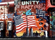 In memory of 9/11. You can see the hats of the various departments engaged in helping people trapped inside the Twin Towers | In memory of 9-11 | New York Murales