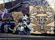 A mum reading a paper. In the back stars and the writtens Boston and New York | Long Island | 5 Pointz | New York Murales