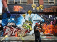 A muralist and some creatures on the back | Long Island | 5 Pointz | New York Murales