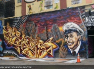 A policeman in front of a New York City, surrounded by the flames | Long Island | 5 Pointz | New York Murales