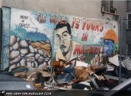 Trash in front of the wall can't give us even a name to remember | In memory of... | New York Murales
